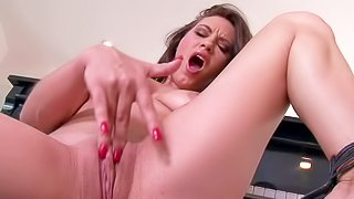Juliette Bardot is a naughty girl who plays with her bald pussy after playing piano. Bad girl with natural tits keeps her legs spread apart as long as she strokes her snatch